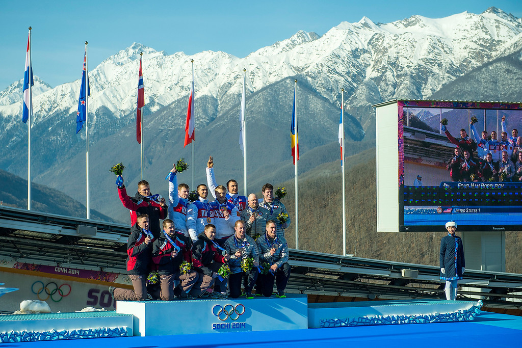 . Team Latvia, Russia and USA celebrate during the medal ceremony at the finish of the four-man bobsled at Sanki Sliding Center during the 2014 Sochi Olympics Sunday February 23, 2014. Russia won gold. Latvia won silver and USA won bronze.  (Photo by Chris Detrick/The Salt Lake Tribune)