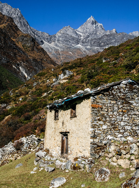 View of stone hut with mountain in background - Nepal - Solukhumbu District