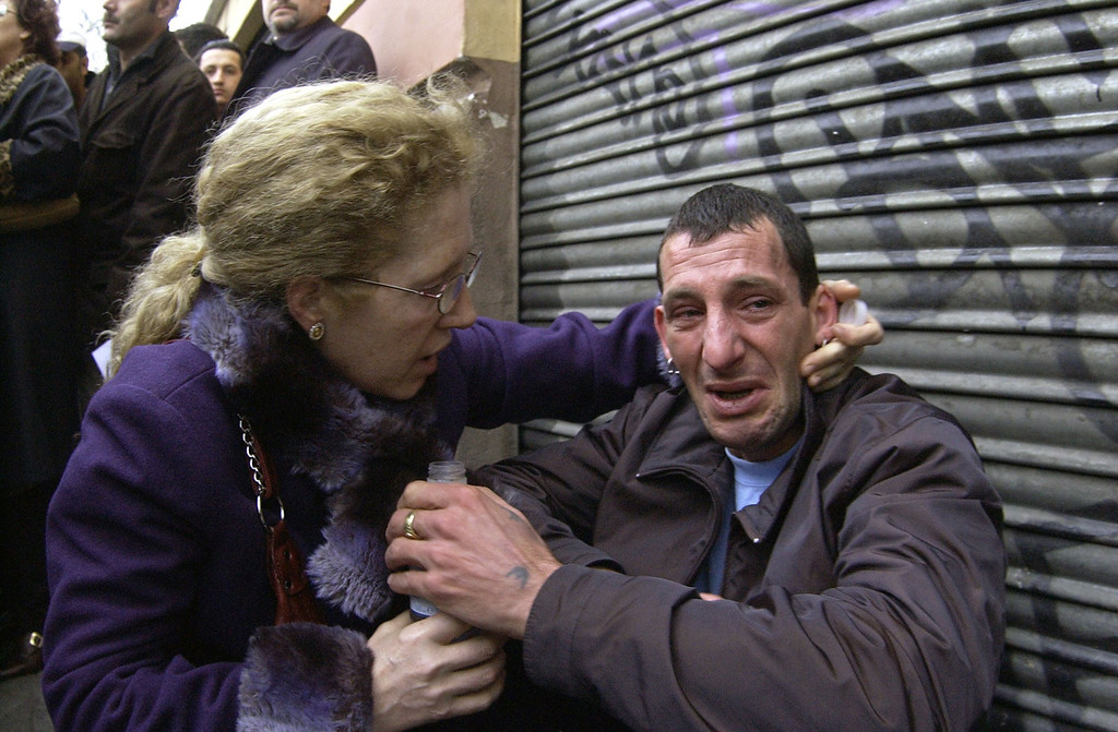 . Victims comfort each other after a train exploded at the Atocha train station in Madrid 11 March 2004. At least 198 people were killed and more than 1,400 wounded in bomb attacks on four commuter trains. RICARDO CASES/AFP/Getty Images