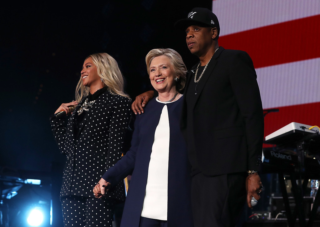 . CLEVELAND, OH - NOVEMBER 04:  (L-R) Beyonce, Democratic presidential nominee former Secretary of State Hillary Clinton and Jay Z appear on stage during a Get Out The Vote concert at Wolstein Center on November 4, 2016 in Cleveland, Ohio. With less than a week to go until election day, Hillary Clinton is campaigning in Pennsylvania, Ohio and Michigan.  (Photo by Justin Sullivan/Getty Images)