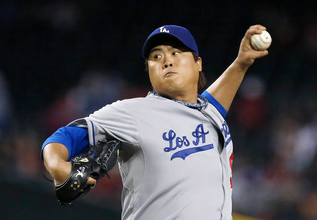 . Los Angeles Dodgers\' Hyun-Jin Ryu throws a pitch to Arizona Diamondbacks\' Paul Goldschmidt for a two-run home run in the first inning of a baseball game on Monday, Sept. 16, 2013, in Phoenix. (AP Photo/Ross D. Franklin)