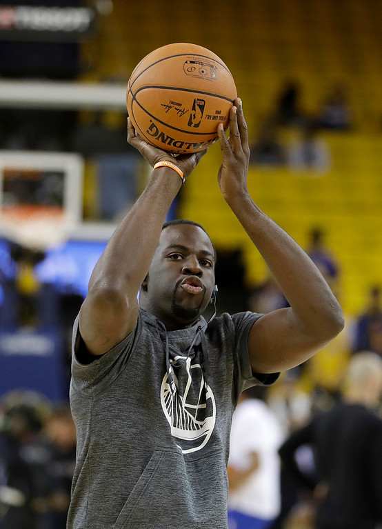 . Golden State Warriors forward Draymond Green warms up before Game 5 of basketball\'s NBA Finals between the Warriors and the Cleveland Cavaliers in Oakland, Calif., Monday, June 12, 2017. (AP Photo/Marcio Jose Sanchez)