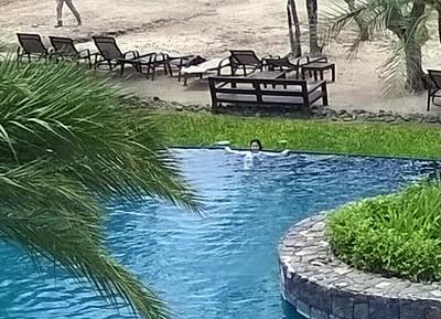 Ella relaxing in the pool.