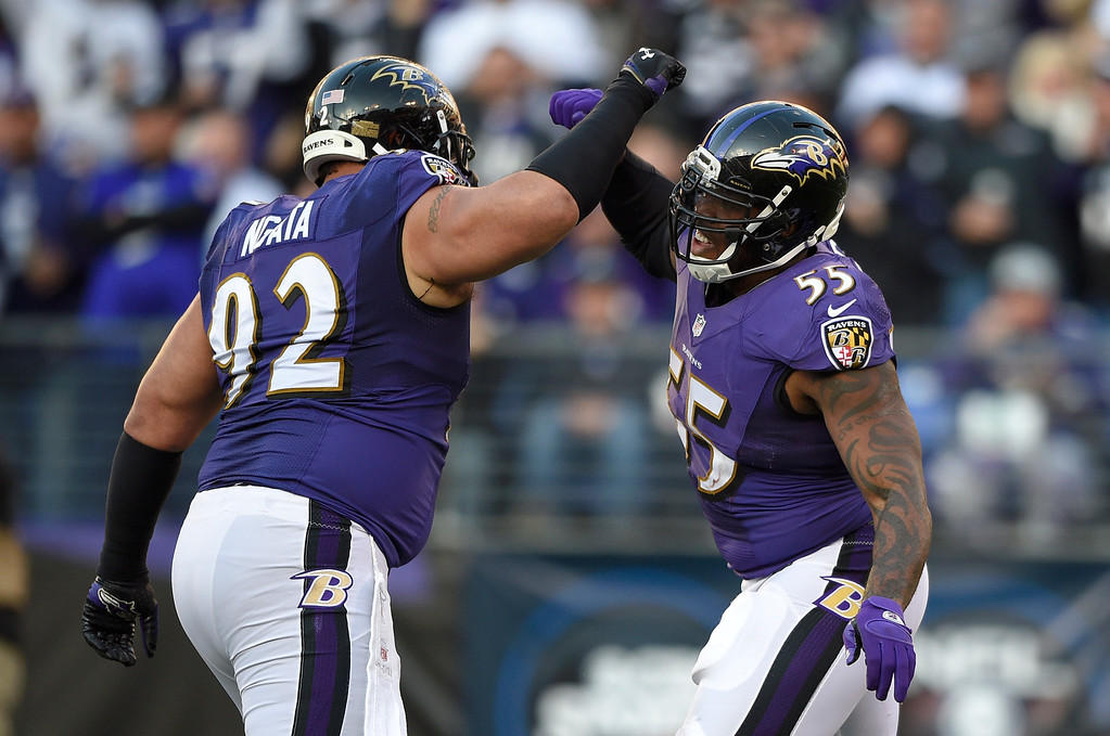 . Baltimore Ravens defensive end Haloti Ngata, left, and outside linebacker Terrell Suggs celebrate after Suggs sacked San Diego Chargers quarterback Philip Rivers in the second half of an NFL football game, Sunday, Nov. 30, 2014, in Baltimore. (AP Photo/Nick Wass)