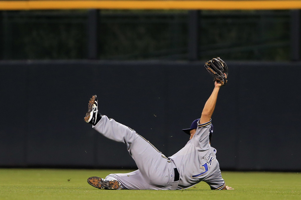 . DENVER, CO - JULY 26:  Right fielder Norichika Aoki #7 of the Milwaukee Brewers makes a sliding catch on a pop fly by DJ LeMahieu #9 of the Colorado Rockies to end the fifth inning at Coors Field on July 26, 2013 in Denver, Colorado.  (Photo by Doug Pensinger/Getty Images)