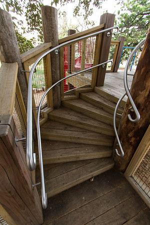 spiral timber stairs with stainless steel hand rail
