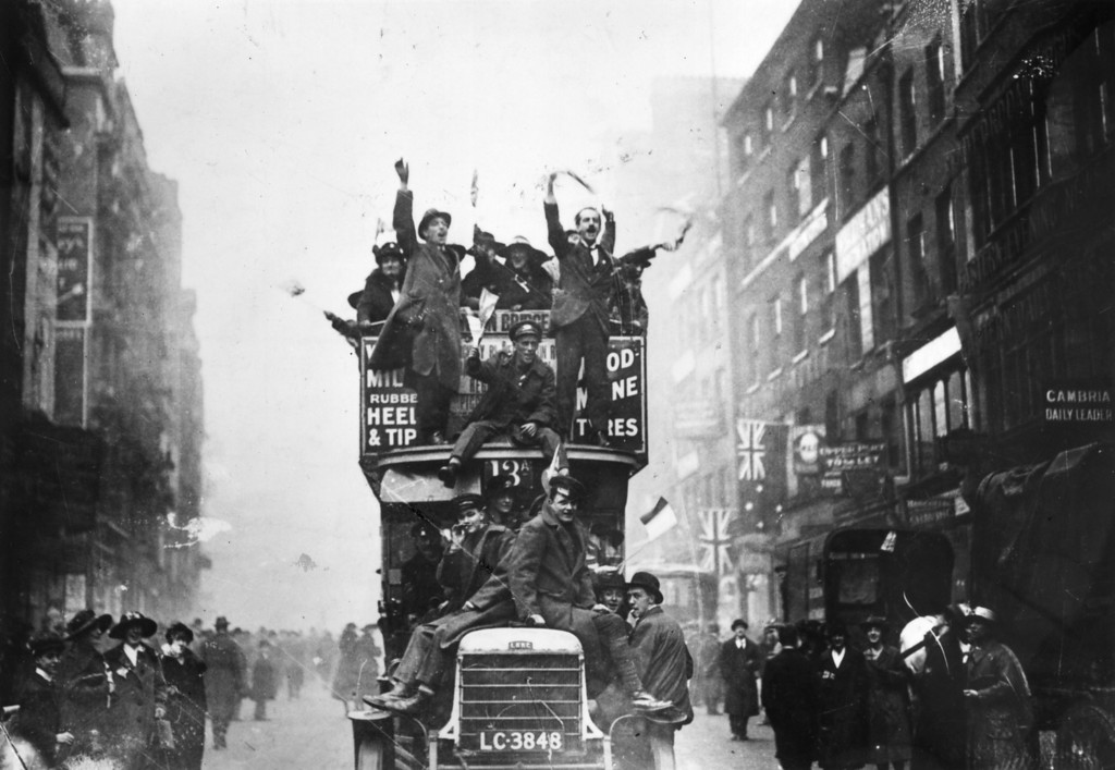 . 11th November 1918:  Crowds celebrating the signing of the Armistice at the end of World War I.  (Photo by Topical Press Agency/Getty Images)