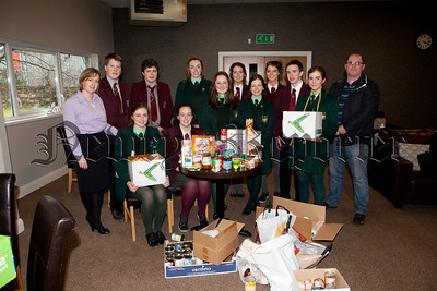 Pupils from St Pauls High School and Sacred Heart GS are pictured at Newry Foodbank presenting a donation to Pastor Mike Holohan. The pupils made the donation as part of First Trusts Build a Bank Challenge and are pictured with Katy McGivern from First Trust. The pupils are through to the Regional Finals which took place on Monday last in Derry. R1509006