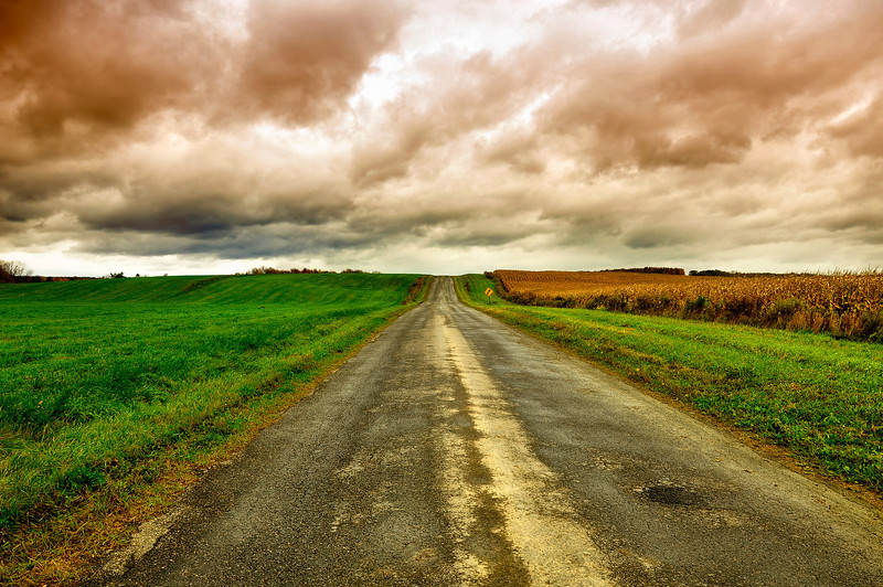Country Road and Stormy Sky.