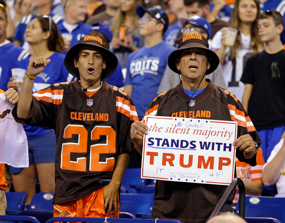 . Cleveland Browns fans hold a sign following the national anthem before an NFL football game between the Indianapolis Colts and the Cleveland Browns in Indianapolis, Sunday, Sept. 24, 2017. (AP Photo/Michael Conroy)