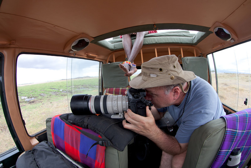 Fred shooting from the vehicle.