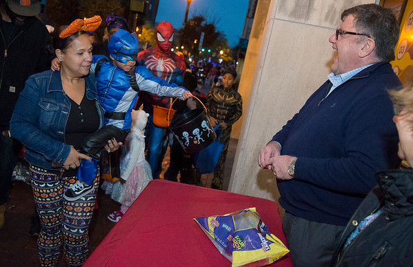 10/31/19 Wesley Bunnell | StaffrrNew Britain Herald Publisher Michael Schroeder passes out candy to trick or treaters during the New Britain Down District Halloween Safe Zone 2019.