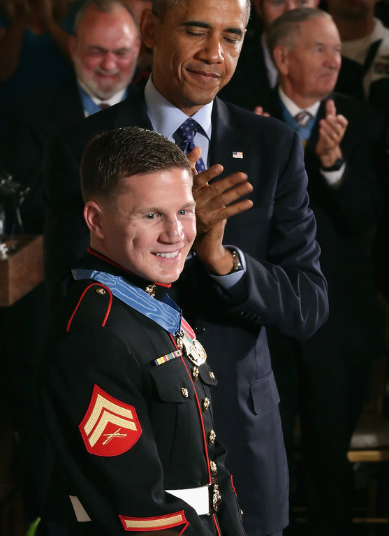 . Retired Marine Cpl. William \'Kyle\' Carpenter receives a round of applause after being awarded the Medal of Honor by U.S. President Barack Obama during a ceremony in the East Room of the White House on June 19, 2014 in Washington, DC.  (Photo by Chip Somodevilla/Getty Images)
