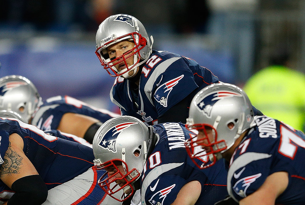 . Tom Brady #12 of the New England Patriots shouts instructions against the Miami Dolphins at Gillette Stadium in the second quarter on December 30, 2012 in Foxboro, Massachusetts. (Photo by Jim Rogash/Getty Images)
