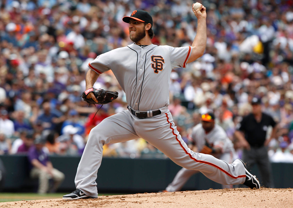 . San Francisco Giants starting pitcher Madison Bumgarner works against the Colorado Rockies in the first inning of a baseball game in Denver on Sunday, June 30, 2013.  (AP Photo/David Zalubowski)