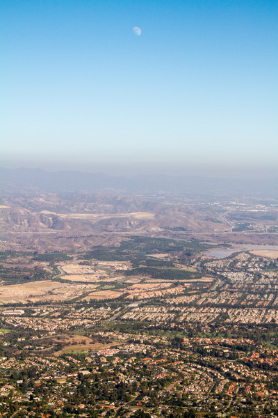 Aerial view of cityscape and mountains in background