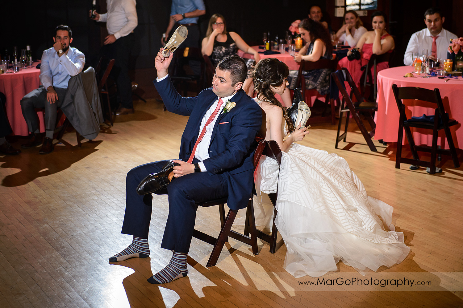 bride and groom playing shoe game during wedding reception at Saratoga Foothill Club