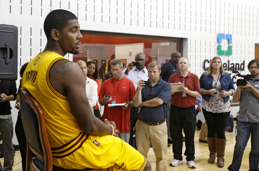 . Cleveland Cavaliers\' Kyrie Irving answers questions during the NBA teams media day Monday, Sept. 30, 2013, in Independence, Ohio. (AP Photo/Tony Dejak)