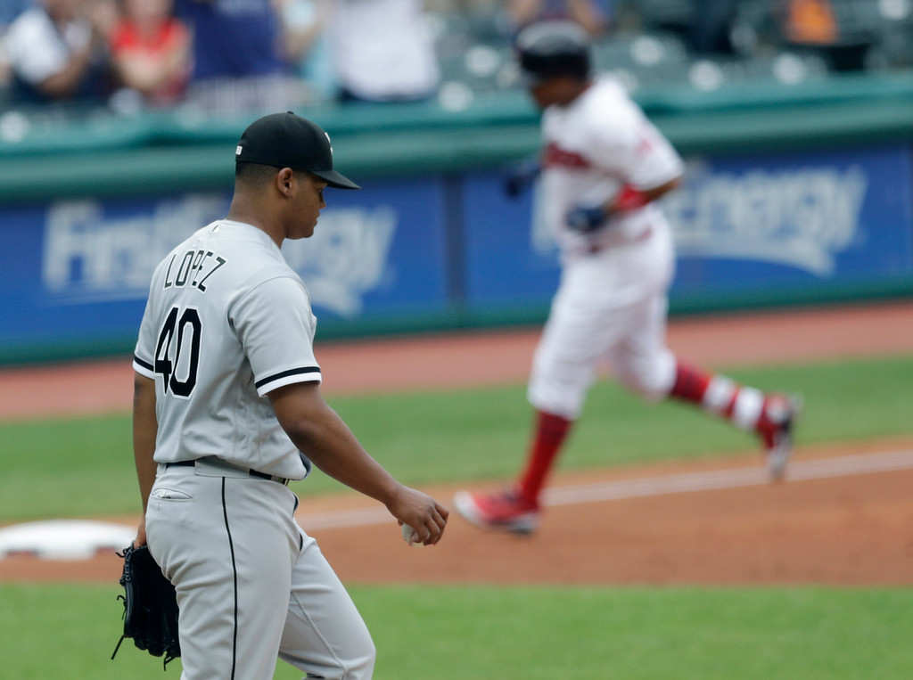 . Chicago White Sox starting pitcher Reynaldo Lopez, left, waits for Cleveland Indians\' Jose Ramirez to run the bases after Ramirez hit a three-run home run in the first inning of a baseball game, Wednesday, June 20, 2018, in Cleveland. Francisco Lindor and Michael Brantley scored. (AP Photo/Tony Dejak)