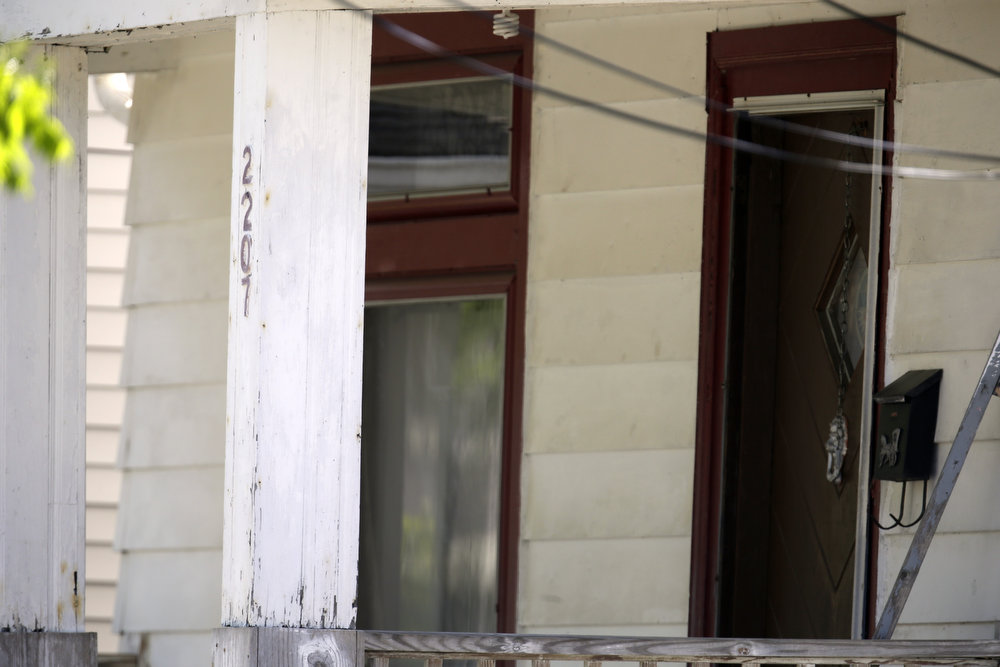 . The front entrance to the house where three women were held is shown in Cleveland, Ohio, Thursday, May 9, 2013.  Ariel Castro was charged with four counts of kidnapping and three counts of rape.   (AP Photo/David Duprey)