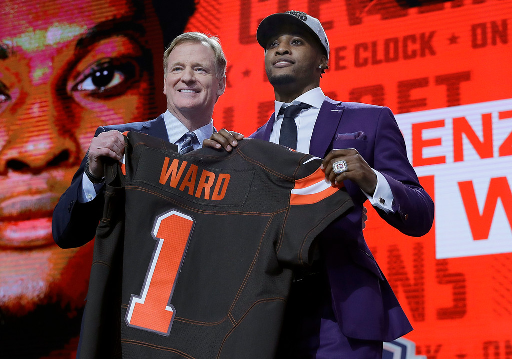 . Ohio State\'s Denzel Ward, right, poses with Commissioner Roger Goodell after being selected by the Cleveland Browns during the first round of the NFL football draft, Thursday, April 26, 2018, in Arlington, Texas. (AP Photo/David J. Phillip)