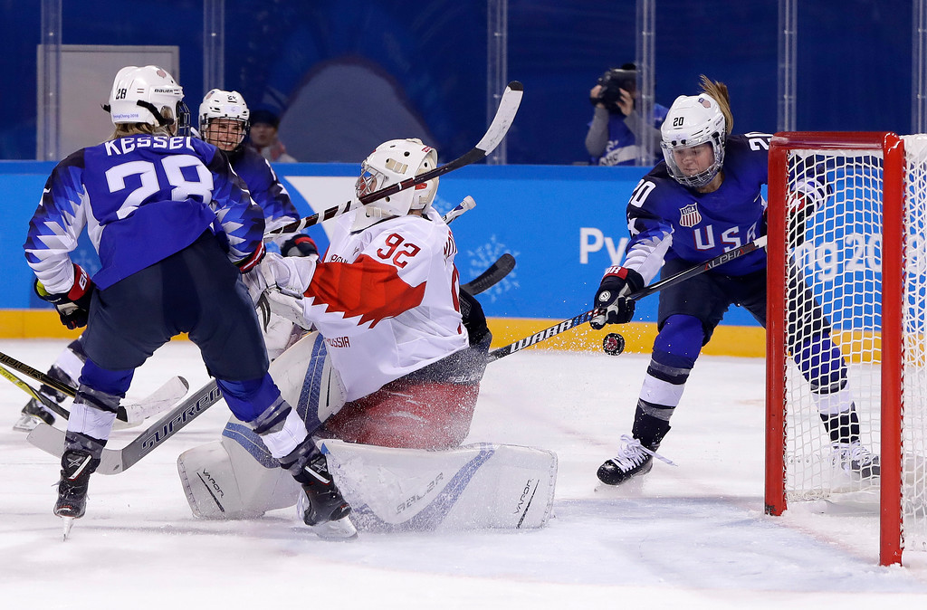 . Hannah Brandt (20), of the United States, scores a goal against Russian athlete Nadezhda Morozova (92) during the third period of the preliminary round of the women\'s hockey game at the 2018 Winter Olympics in Gangneung, South Korea, Tuesday, Feb. 13, 2018. (AP Photo/Matt Slocum)