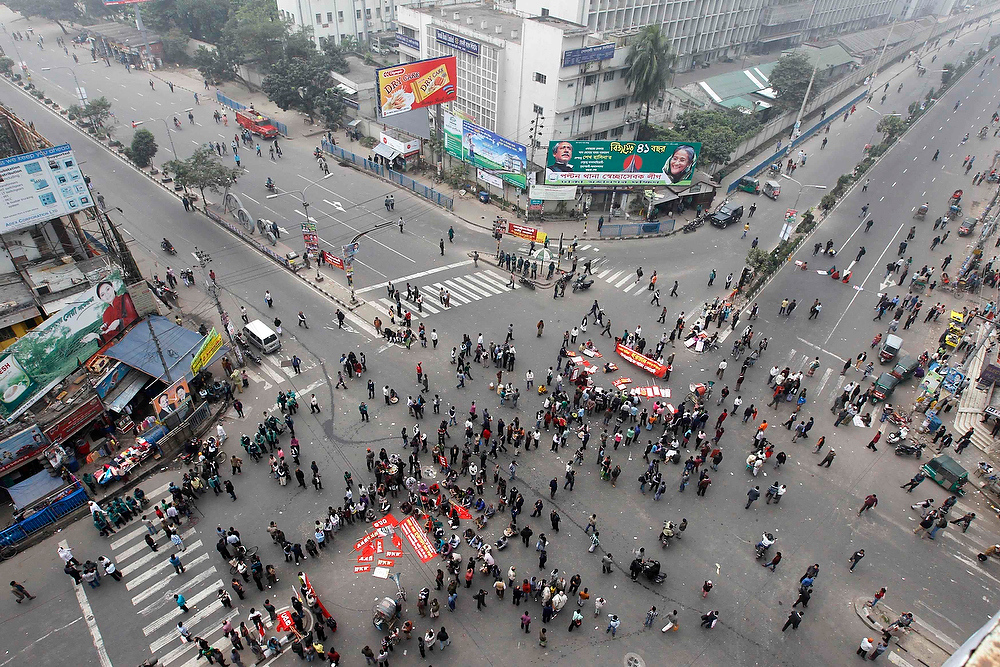 . Activists of the Communist Party of Bangladesh hold a rally on a usually busy street during a strike in Dhaka December 18, 2012. The CPB and the Bangladesh Samajtantrik Dal (BSD) called for a countrywide shutdown on Tuesday, demanding a ban on the Jamaat-e-Islami, a radical Islamist party, and for a quicker trial of war criminals, local media reported. REUTERS/Andrew Biraj