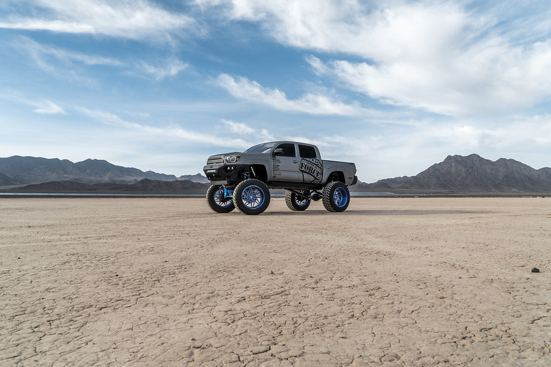 @T_harper96 @Vengeance_tacoma 2005-15 Toyota Tacoma featuring our New 2019 Concave 24x14 Lollipop Blue #GENESIS wrapped in 40x1550x24 @NittoTire-87.jpg