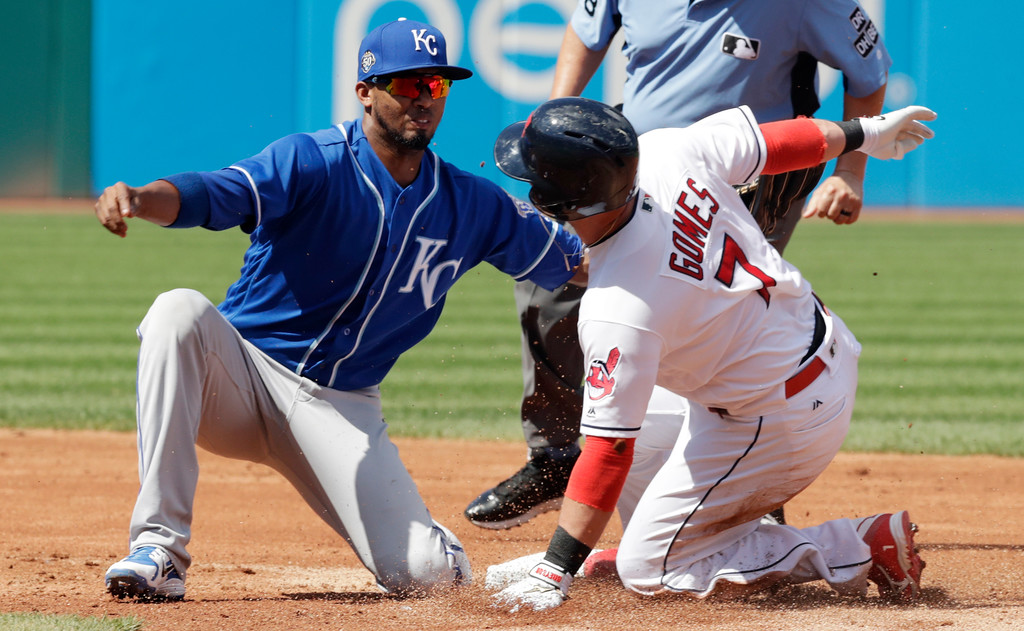 . Cleveland Indians\' Yan Gomes is tagged out at second base by Kansas City Royals\' Alcides Escobar in the second inning of a baseball game, Wednesday, Sept. 5, 2018, in Cleveland. Gomes hit a single and attempted to advance to second base. (AP Photo/Tony Dejak)