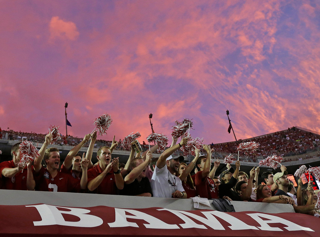 . Alabama fans cheer following a score against Colorado State during the first half of an NCAA college football game in Tuscaloosa, Ala., Saturday, Sept. 21, 2013. (AP Photo/Dave Martin)