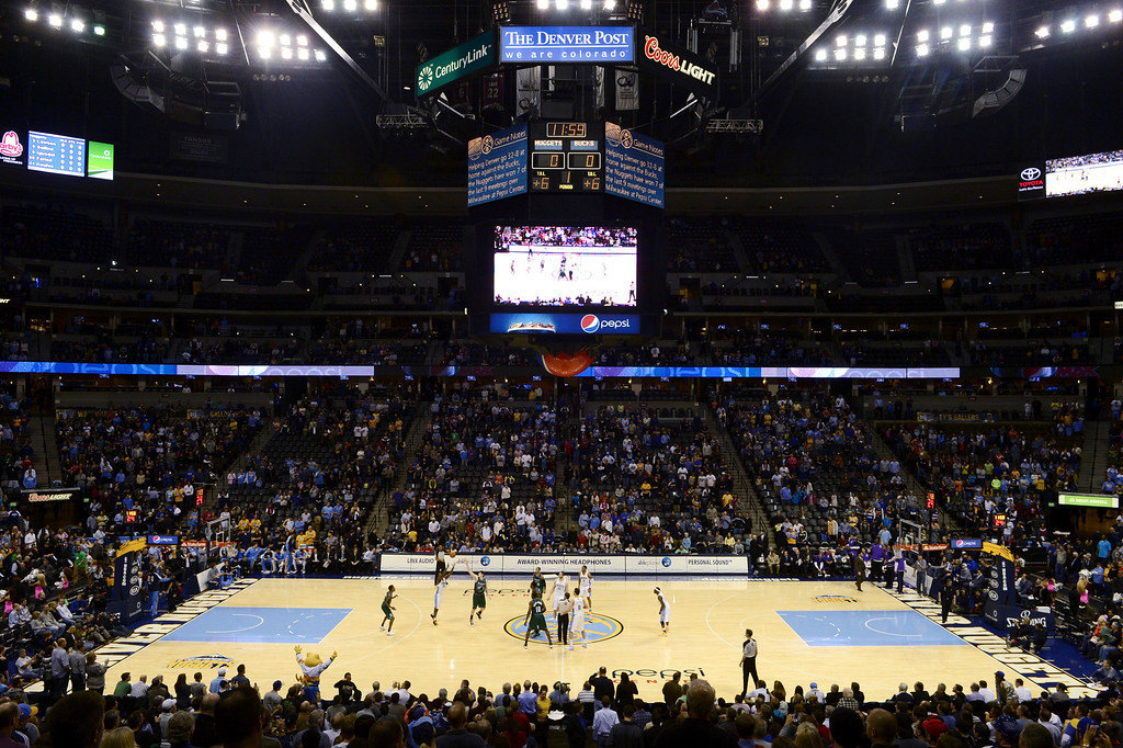 . DENVER, CO - FEBRUARY 5: The Denver Nuggets take on the Milwaukee Bucks on a new floor at the Pepsi Center. This image is from one second into the new floor\'s run. (Photo By AAron Ontiveroz/The Denver Post)