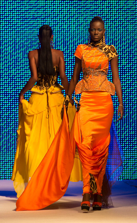 . Models wears creations by designer Habib Sangare of Ivory Coast, at Hotel des Almadies, in Dakar, Senegal, Saturday, June 22, 2013. After a Friday show held in a dusty marketplace in the working class suburb of Guediawaye, the runway finale of Dakar Fashion Week was held at a luxury hotel and showcased the work of 14 designers from West Africa, Europe, South America, and the Caribbean. (AP Photo/Rebecca Blackwell)