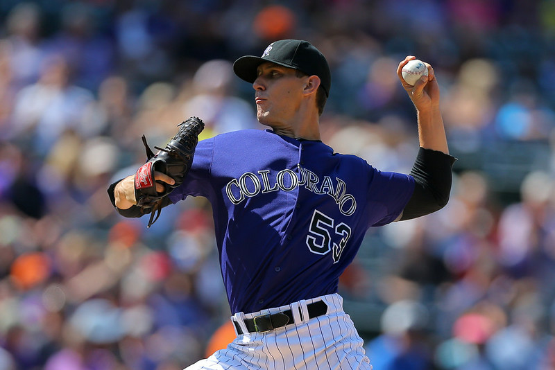 . Relief pitcher Christian Friedrich #53 of the Colorado Rockies delivers to home plate during the seventh inning against the San Francisco Giants at Coors Field on September 1, 2014 in Denver, Colorado. The teams were resuming a game previously suspended in the sixth inning on May 22 due to rain.  (Photo by Justin Edmonds/Getty Images)