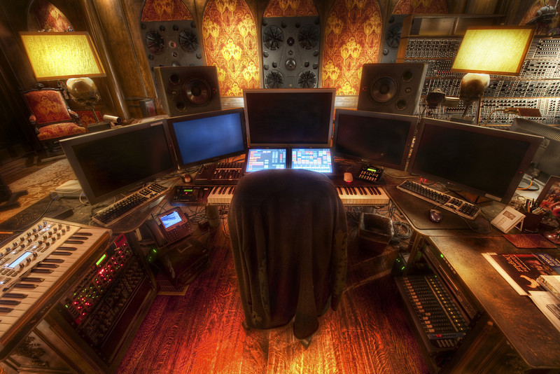 """Hans Zimmer's Studio It takes me a long time to process these photos, as you guys know by now.  This is good and bad...  One side-benefit of the """"good"""" is that it allows me to leave many open threads and story-lines that are continued for months and years on end (much like Lost, where certain bits get lost forever).  For example, I know everyone is waiting to hear about the dead body I saw in Indonesia...  people love dead body stories.  But you have to wait for the next Indonesia street shot for that!  Hehe...Today, I have three more photos from the studio. The first is his massive bank of monitors that almost circumnavigate his keyboard.  His team blanked out all the monitors so I could not capture his next secret project (which is not nearly as cool as his secret project with me, which is, indeed, so secret that Hans does not even know about it yet).- Trey RatcliffClick here to read the rest of this post at the Stuck in Customs blog."""
