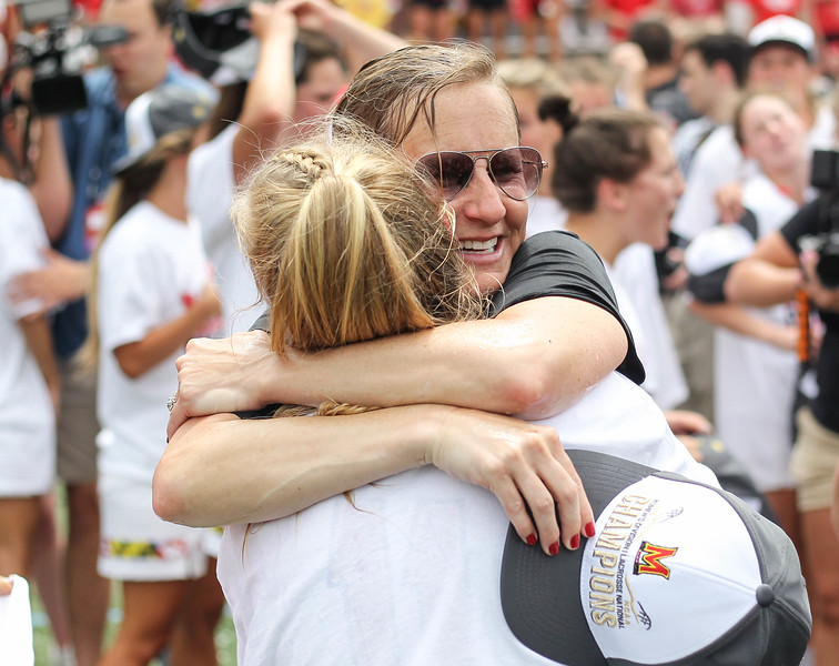 May 26, 2019: Maryland head coach Cathy Reese and attacker Caroline Steele embrace each other after NCAA Womens Lacrosse Semi-finals matchup between Boston College and University of Maryland in Baltimore. Photos by Chris Thompkins/Prince Georges Sentinel