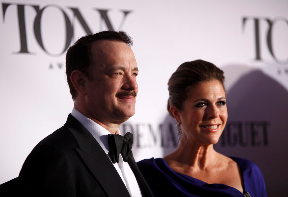 ". Actor Tom Hanks and his wife Rita Wilson arrive to the American Theatre Wing\'s annual Tony Awards in New York June 9, 2013. Hanks is nominated for best performance by an actor in a leading role in a play for ""Lucky Guy.\"" REUTERS/Carlo Allegri"