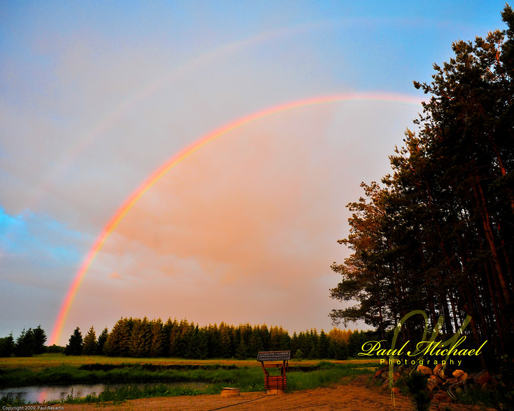 rainbow in Lithuania over forest.