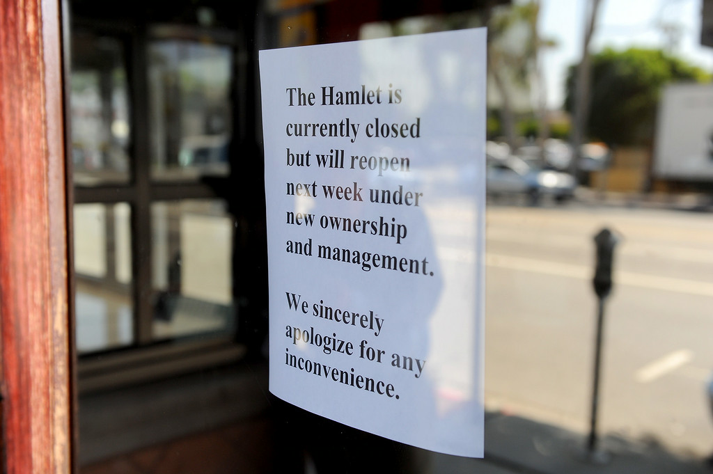 . A sign pasted to the front door says Hamburger Hamlet will reopen next week under new ownership, Wednesday, July 2, 2014. (Photo by Michael Owen Baker/Los Angeles Daily News)