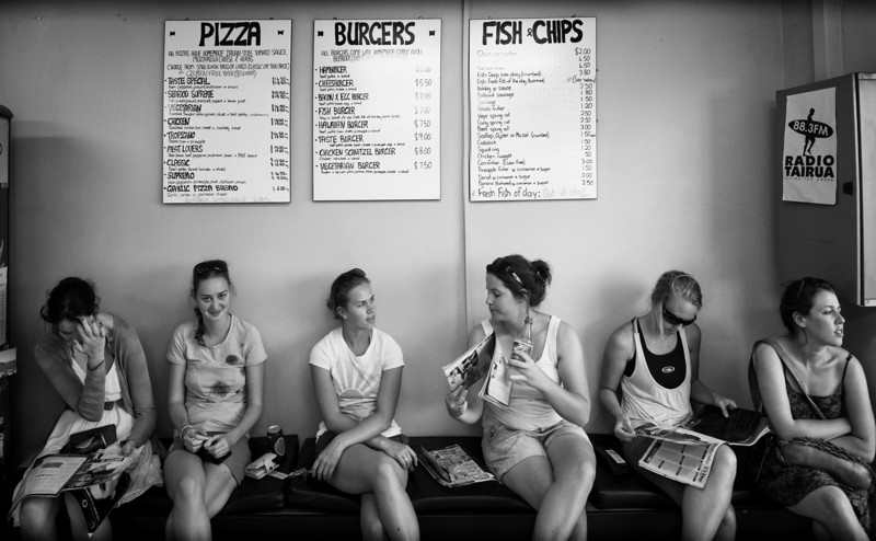 Six Girls in New Zealand Getting Meat While on a long drive from the Coromandel to Matamata (where The Shire is), we pulled into this pizza place to stock up on some much needed carbs.  I saw these six girls lined up so perfectly, I had to grab a quick shot.Most places in New Zealand outside of the cities seem to shut down about 8 PM.  I had to start getting used to planning ahead to get dinner!  It's hard for me because I usually just go go go go until after sunset, taking photos like a madman... and THEN I think about dinner.   But that trick doesn't really work when you're on the road there...- Trey RatcliffClick here to read the rest of this post at the Stuck in Customs blog.