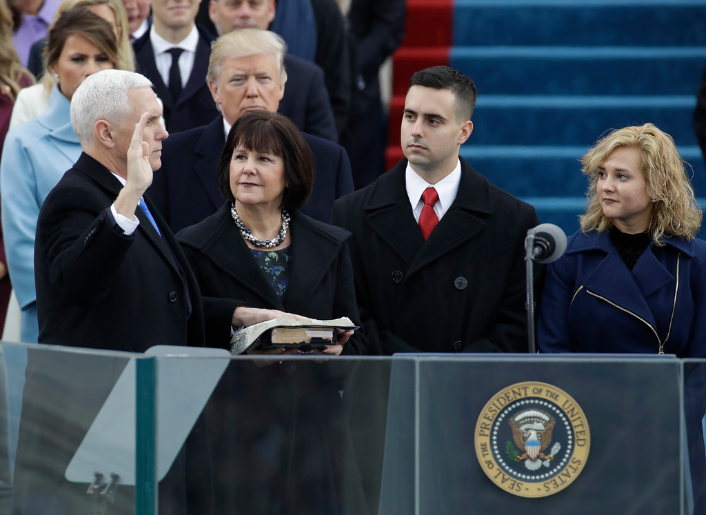 . Vice President-elect Mike Pence, flanked by his wife Karen, is sworn in during the 58th Presidential Inauguration at the U.S. Capitol in Washington, Friday, Jan. 20, 2017. (AP Photo/Patrick Semansky)