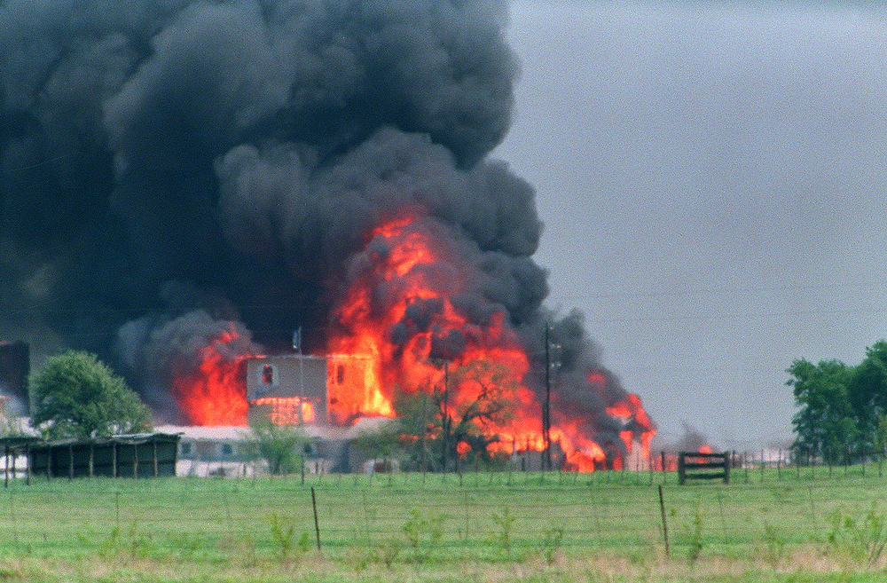 Description of . The Branch Davidian Compound observation tower is engulfed in flames after a fire started inside the compound on April 19, 1993. After a shootout in Waco in 1993 that killed four federal agents and six members of the Branch Davidian religious sect, authorities negotiated with cult leader David Koresh for 51 days. On the final day a few hours after a government tank rammed the cult's wooden fortress, the siege ended in a fiery blaze, killing Koresh and 80 of his followers.  BOB DAEMMRICH/AFP/Getty Images