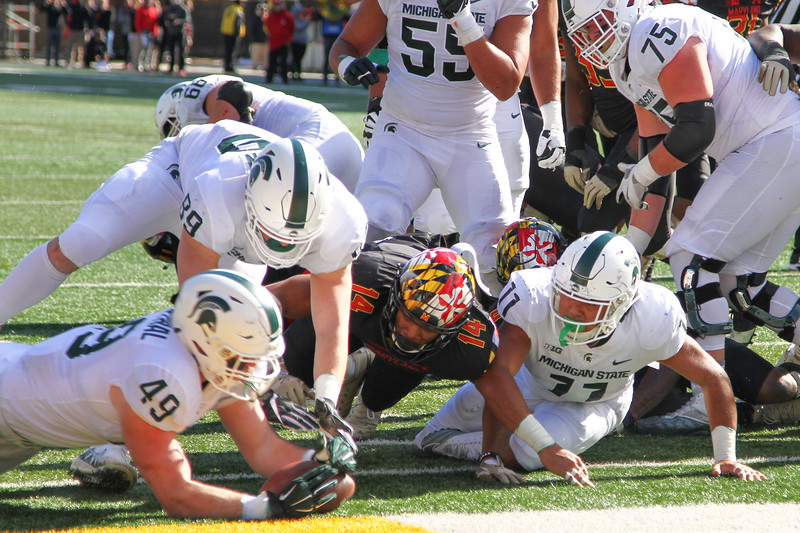 Michigan State FB #49 Matt Rosenthal seizes the fumbled ball in the endzone for a touchdown