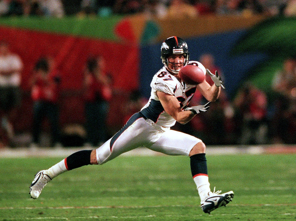 . Denver Broncos Ed McCaffrey pulls in a John Elway  pass against the Atlanta Falcons during the 3rd quarter of Super  Bowl XXXIII at Pro Player Stadium.  (Karl Gehring/The Denver Post)