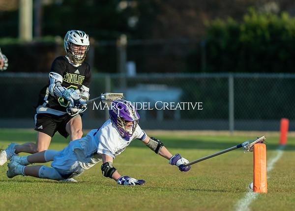 Broughton boys varsity lacrosse vs Enloe. March 10, 2020. D4S_8087