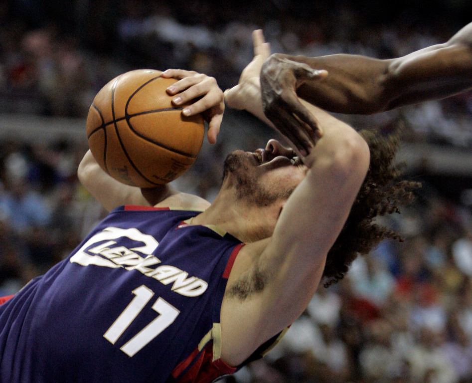 . Cleveland Cavaliers center Anderson Varejao of Brazil (17) is fouled by Detroit Pistons forward Antonio McDyess, right, during the first quarter of an NBA Eastern Conference final basketball game at the Palace of Auburn Hills, Mich., Thursday, May 31, 2007. McDyess was ejected for the hard foul.  (AP Photo/Paul Sancya)