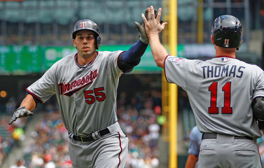 . Minnesota\'s Chris Colabello, left, is congratulated by teammate Clete Thomas after hitting a two-run home run to dead center against the Mariners in the second inning.  (Photo by Otto Greule Jr/Getty Images)