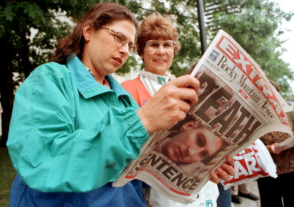 . DENVER, CO - JUNE 13:  Wendy Heiser (L) and Dee Weiland read an extra edition of the Rocky Mountain News in front of the Byron G. Rogers Federal Building and United States Court House in Denver, Colorado moments after hearing Timothy McVeigh had received the death sentence13 June. A jury convicted McVeigh 02 June on 11 counts of murder and conspiracy stemming from the 19 April, 1995 Oklahoma City bombing.  (DOUG COLLIER/AFP/Getty Images)