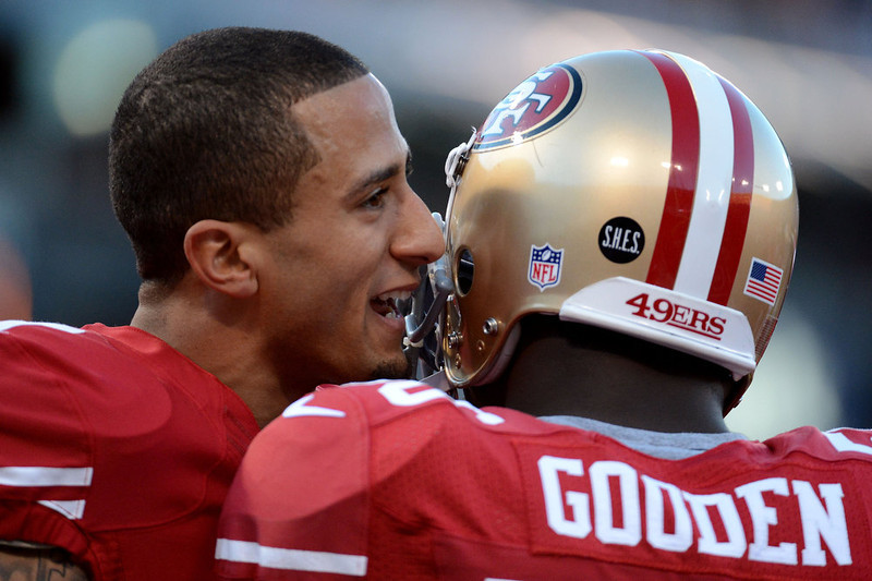 . Quarterback Colin Kaepernick #7 of the San Francisco 49ers talks with linebacker Tavares Gooden #56 during warm ups prior to the NFC Divisional Playoff Game against the Green Bay Packers at Candlestick Park on January 12, 2013 in San Francisco, California.  (Photo by Harry How/Getty Images)