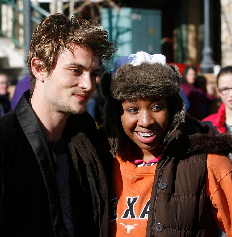 . Rick Egan  | The Salt Lake Tribune   Actor, Shiloh Fernandez (left) poses with Ayaana Pupai (right) 14, Bountiful, on Main Street in Park City, Sunday, January 20, 2013.