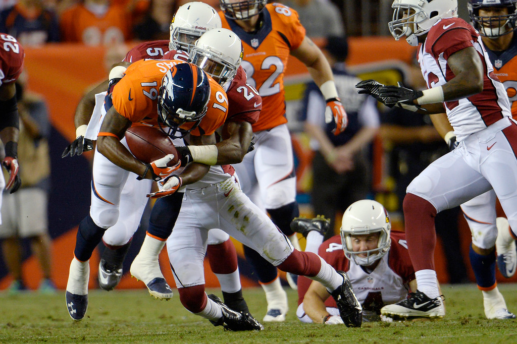 . Antoine Cason (20) of the Arizona Cardinals tackles Lamaar Thomas (19) of the Denver Broncos during the last pre-season game of the season at Sports Authority Field at Mile High. August 29, 2013 Denver, Colorado. (Photo By Joe Amon/The Denver Post)